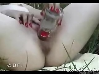 Outdoor zoophilia porn with a slim babe and her horny dog