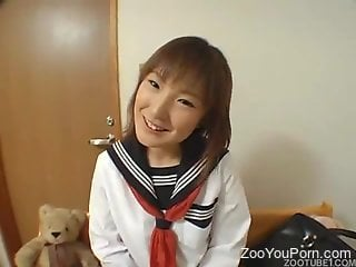 Japanese teen gets licked and fucked by the dog in a kinky show