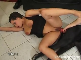 Sexy woman feels amazing with the wet cock of her dog in her