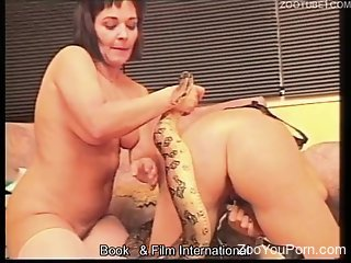 Two sluts fooling around with an actual snake