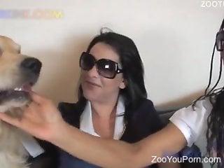 Two Latina babes sharing a dog's throbbing cock