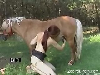 Redheaded zoophile riding a dildo and fucking a horse