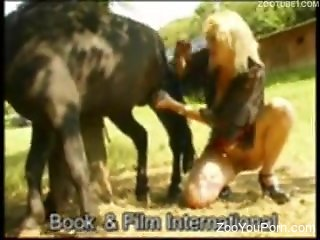 Vintage zoo fuck scene focusing on a blond-haired MILF